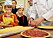 Belgium Prince Laurent, Princess Claire, Prince Nicolas and Prince Aymeric visits a bakery in belgium limburg for a a bake lesson of a Limburg pie and gingerbread of Hasselt