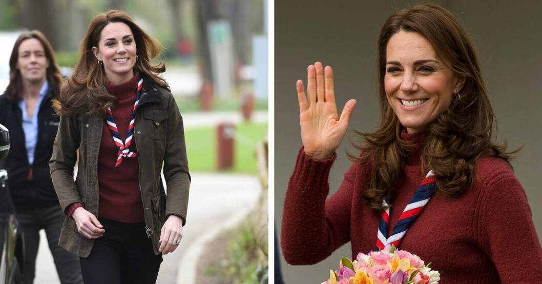 Kate i röd tjocktröja och jacka från Barbour