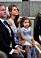 Prinsessan Madeleine var hemma från Florida. Här med prinsessan Adrienne i knät