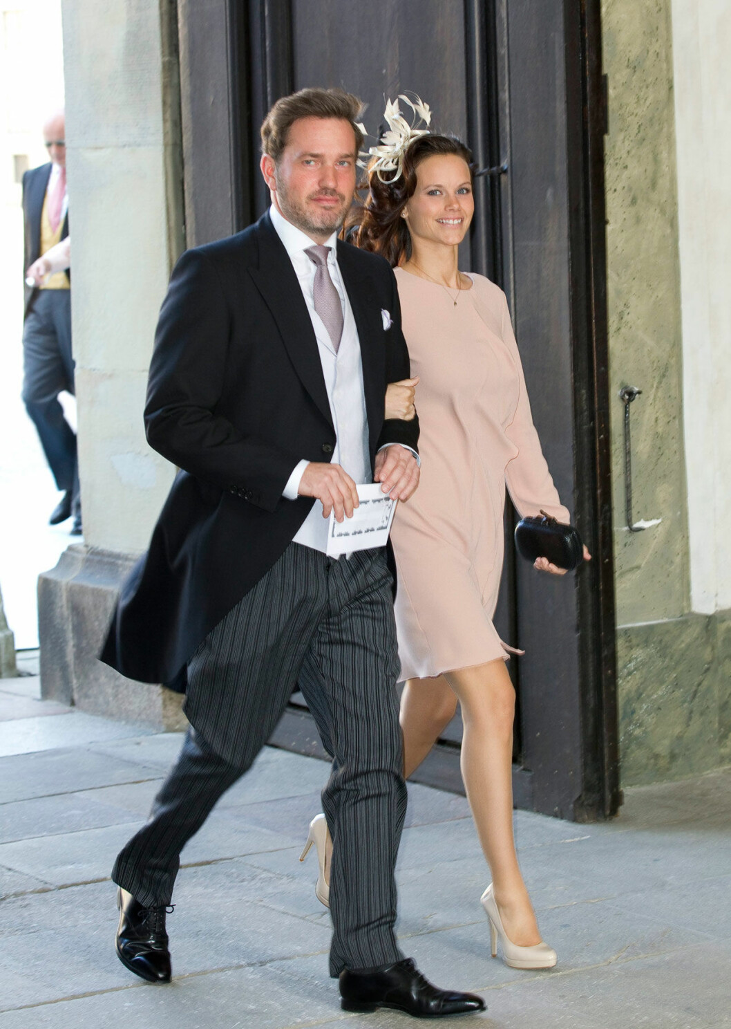 Chris O'Neill och prinsessan Sofia (som då hette Hellqvist) arm i arm på Estelles dop 2012.
